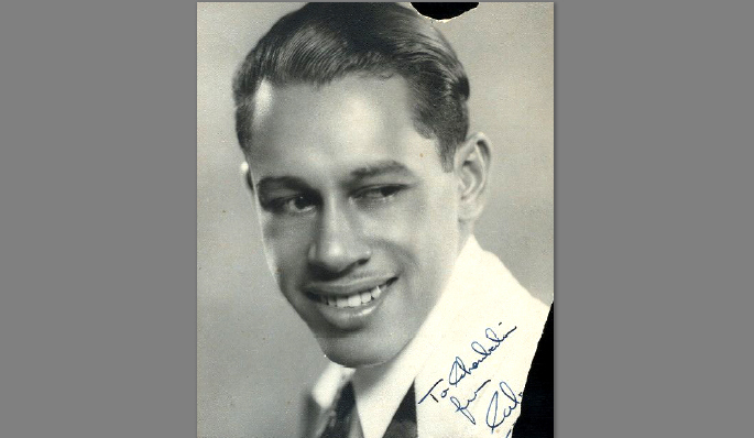 A young Cab Calloway. After graduating from Douglas High School in 1925, he moved to Chiago to live with his sister Blanche, also a musical protege. There he became best friends with Louis Armstrong. By 1929, Calloway's band was so good, he was asked to fill in for Ellington at New York''s Cotton Club. Two years later, he released the hit single,