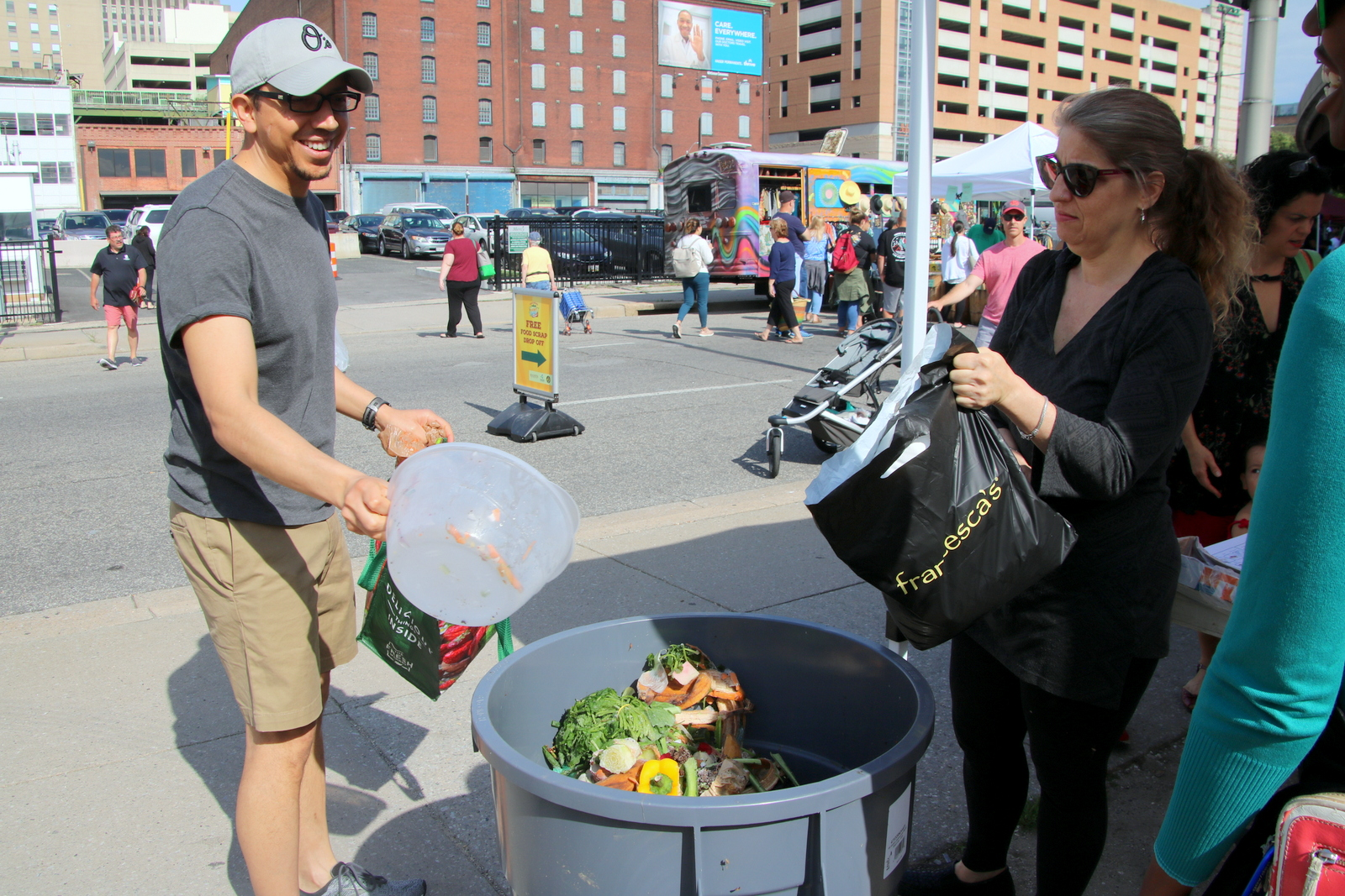 Baltimore's Office of Sustainability is at the Sunday farmer's market this summer, accepting food waste for composting. (Fern Shen)