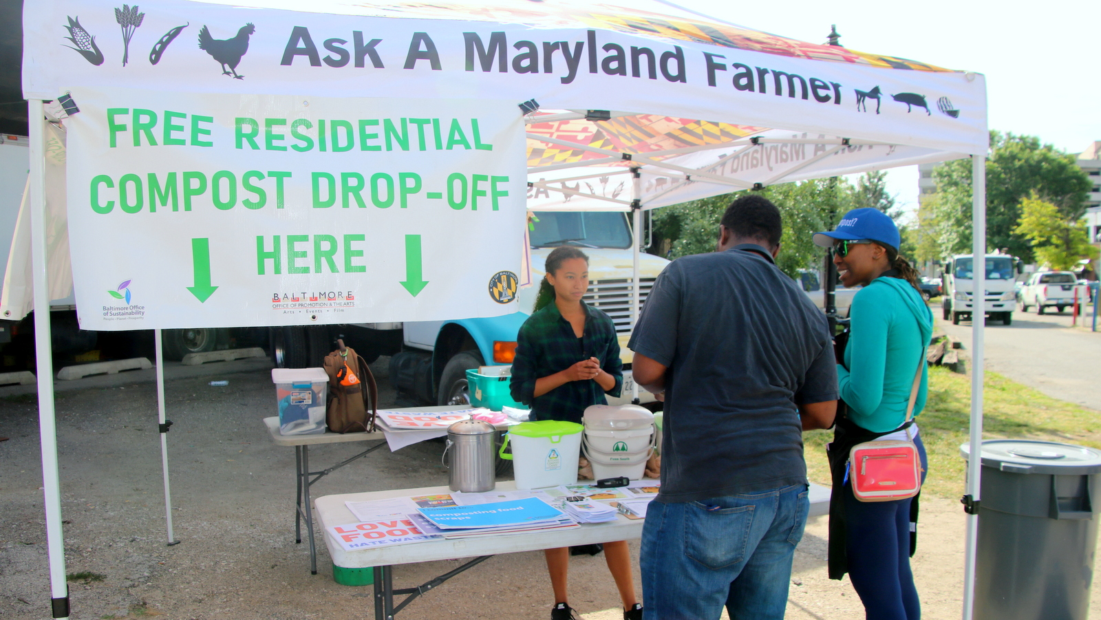 At Baltimore's Sunday farmers market under the Jones Falls Expressway, compostables can be dropped off for free. (Fern Shen)
