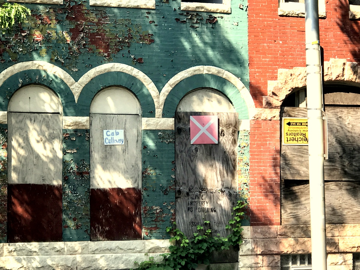 The front of 2216 Druid Hall Avenue includes a homemade sign. (Mark Reutter)