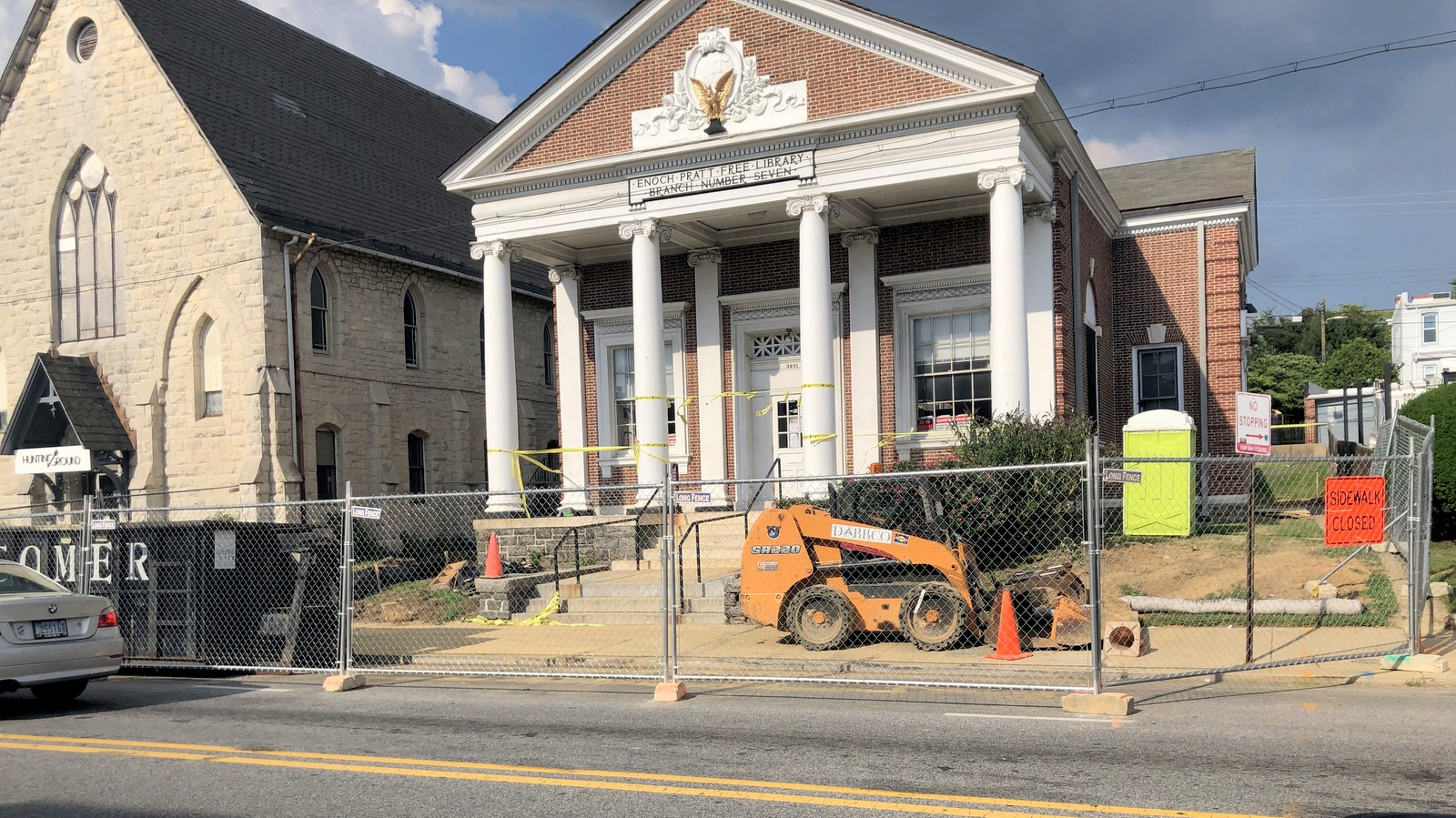 Outside the Hampden branch of the Pratt Library yesterday, construction work narrowed the roadway. (Fern Shen)