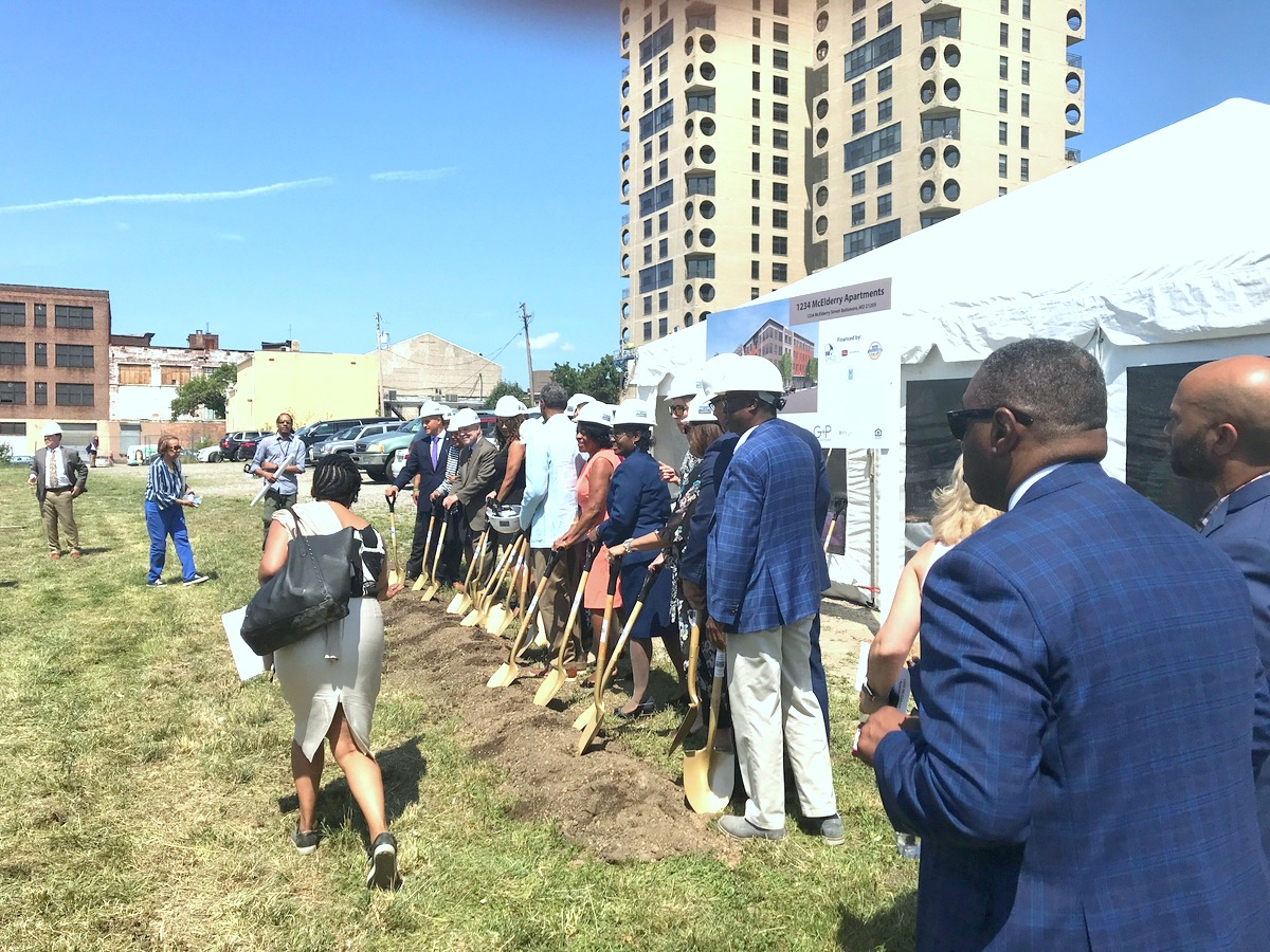 Hard-hatted dignitaries line up for the ceremonial shovel toss at the former site of Somerset public homes. (Mark Reutter)