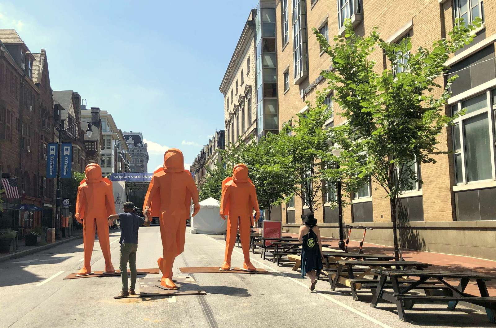 In keeping with this year's theme, three orange moonwalkers are stationed on Charles Street awaiting tonight's opening ceremonies. (Fern Shen)