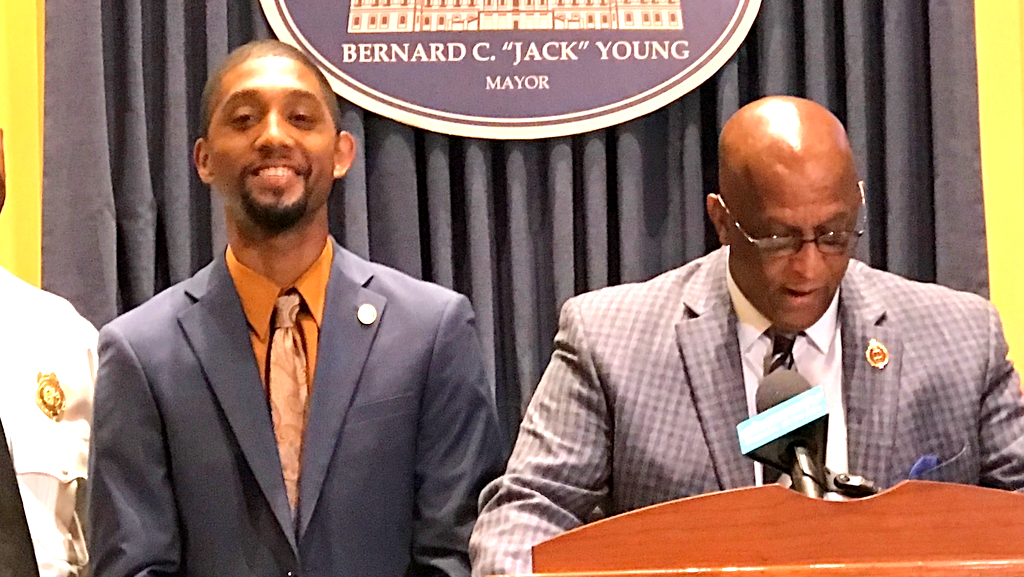 Mayor Jack Young speaks today about July 4th holiday preparations in the Inner Harbor. To his right is City Council President – and potential mayoral rival – Brandon Scott. (Mark Reutter)