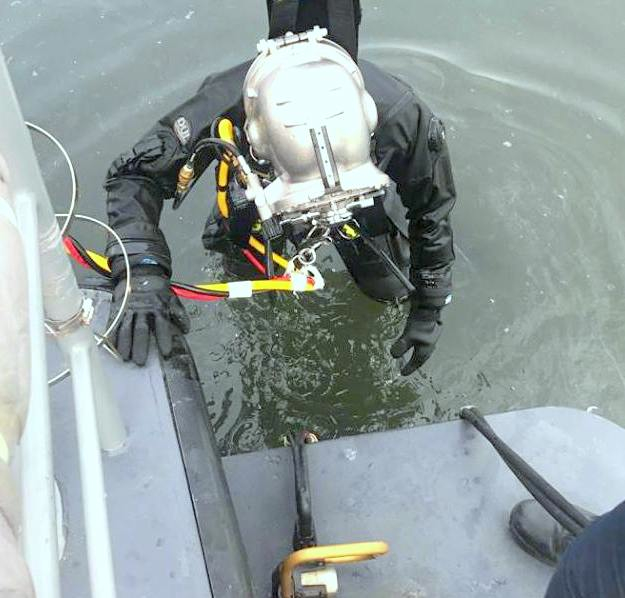 Sgt. Kurt Roepcke with the underwater chainsaw used to cut pilings away from the hull of