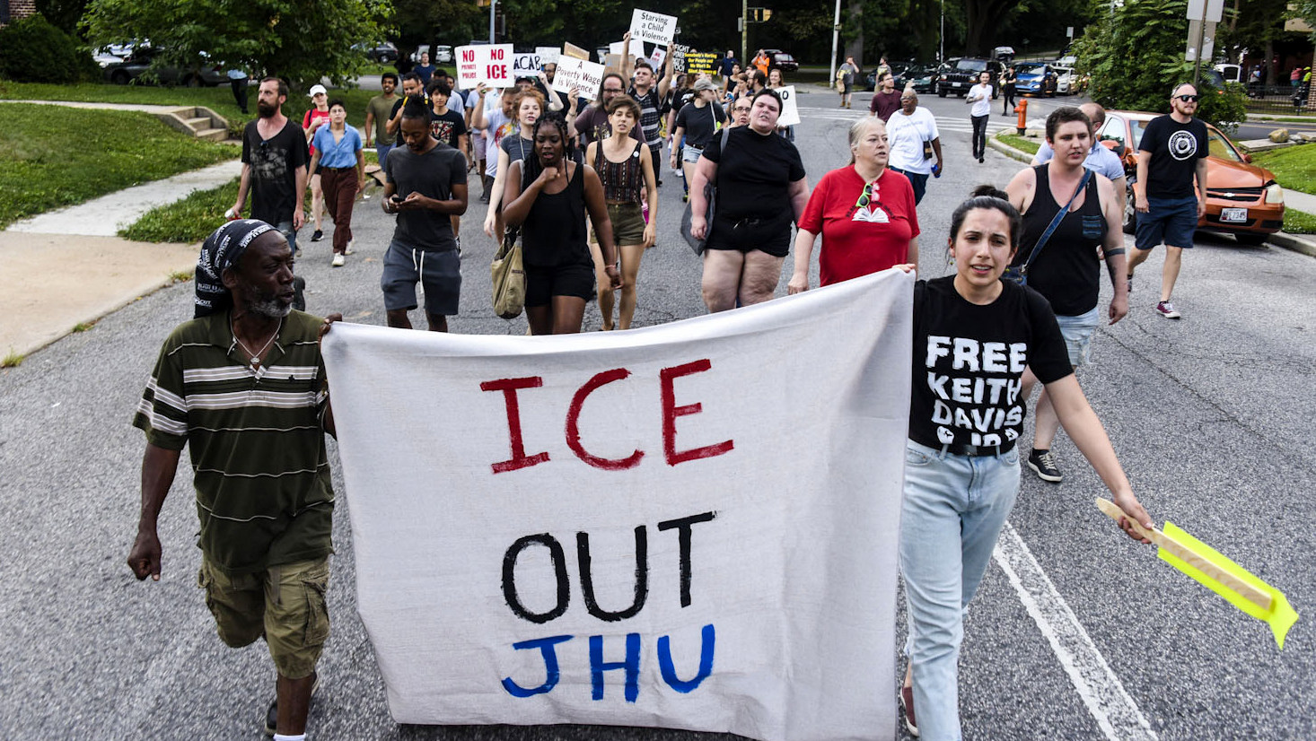 About 150 protesters marched around the Remington to protest Hopkins private police force plan ICE contracts. (J.M. Giordano)