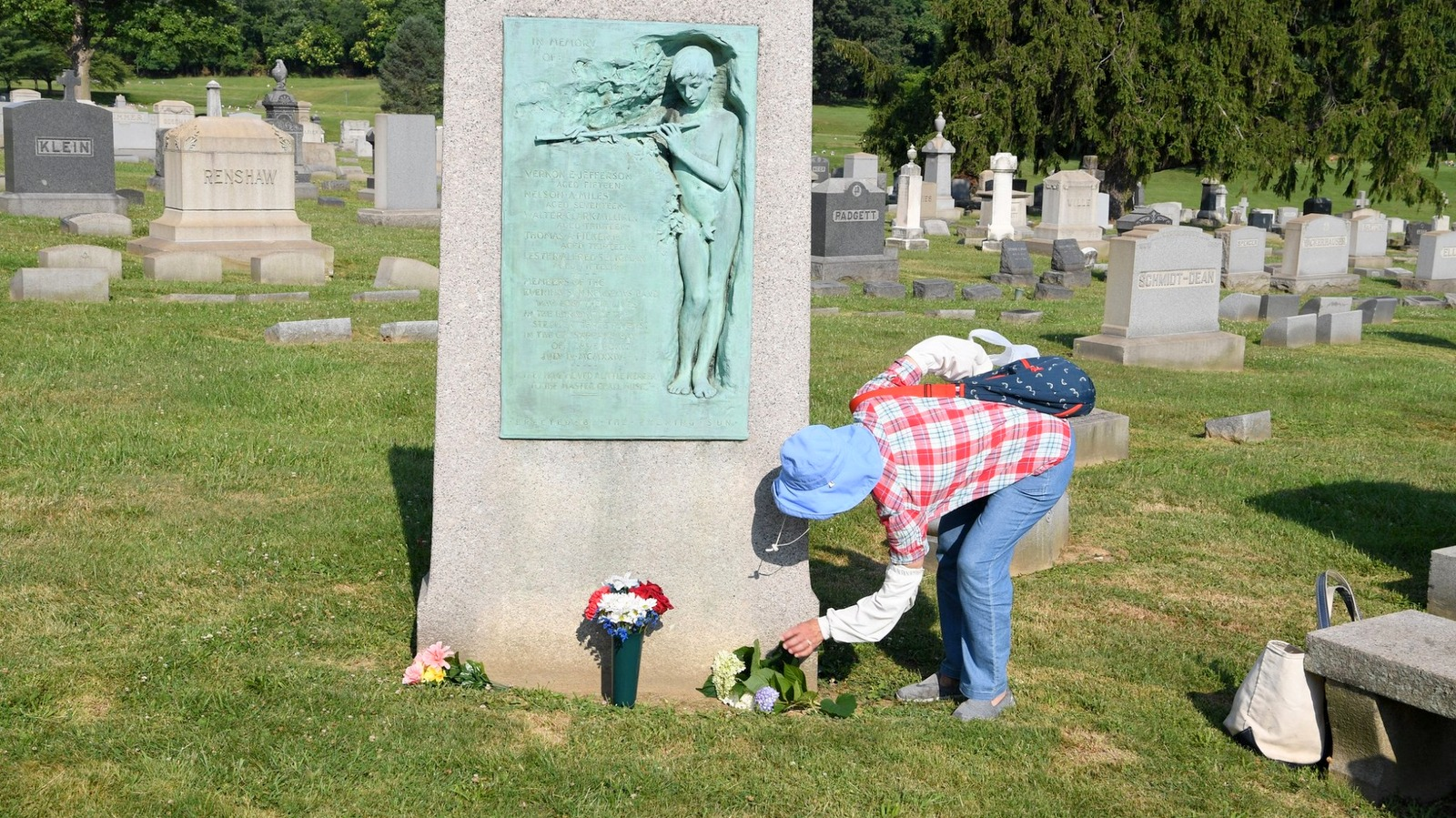 At Baltimore's Loudon Park Cemetery, paying respects at the monument to the five members of The Evening Sun Newsboys' Band who died in a July 4 boat fire in 1924. (Jim Burger)
