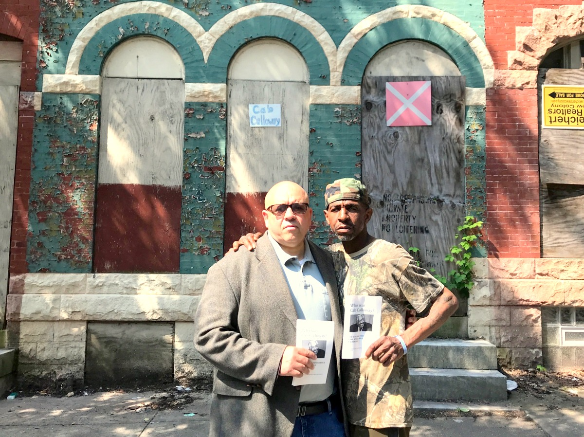 Cab Calloway's grandson Peter Brooks and Druid Heights resdietn Reggie Owens Sr. stand in front of bandleader's childhood home. (Mark Reutter)