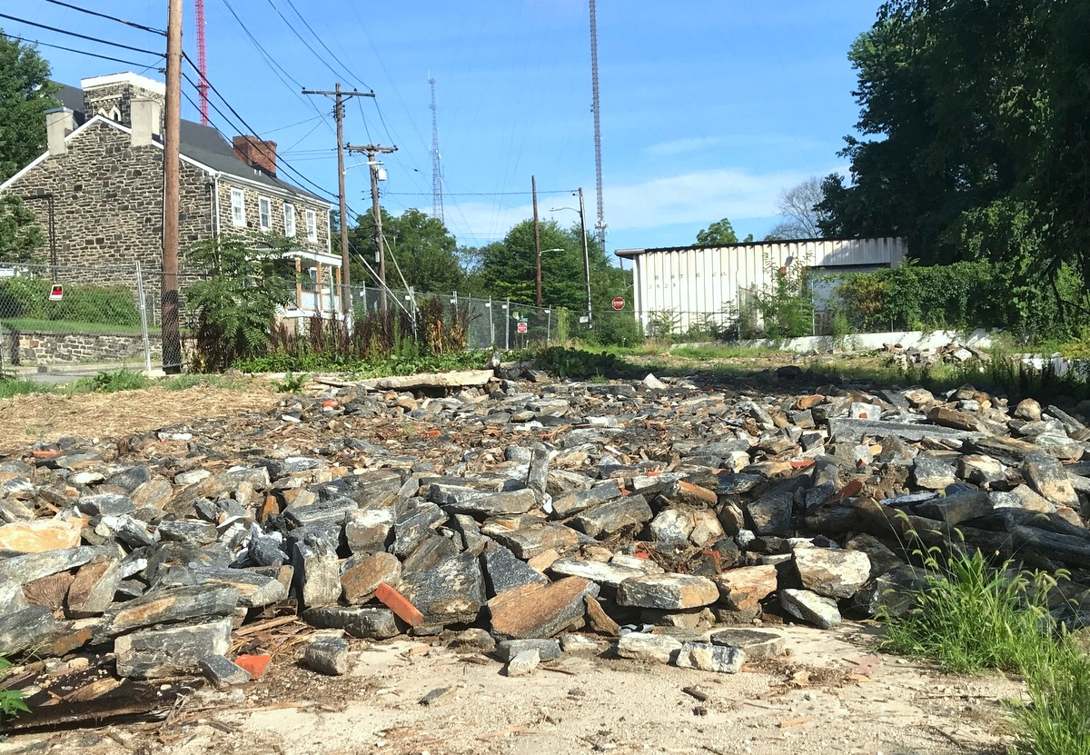 Cleared site on Clipper Road where the 1840s stone houses were razed in May. Jenning's LLC was fined $3,000 for not following city regulations for house demolition. (Mark Reutter)