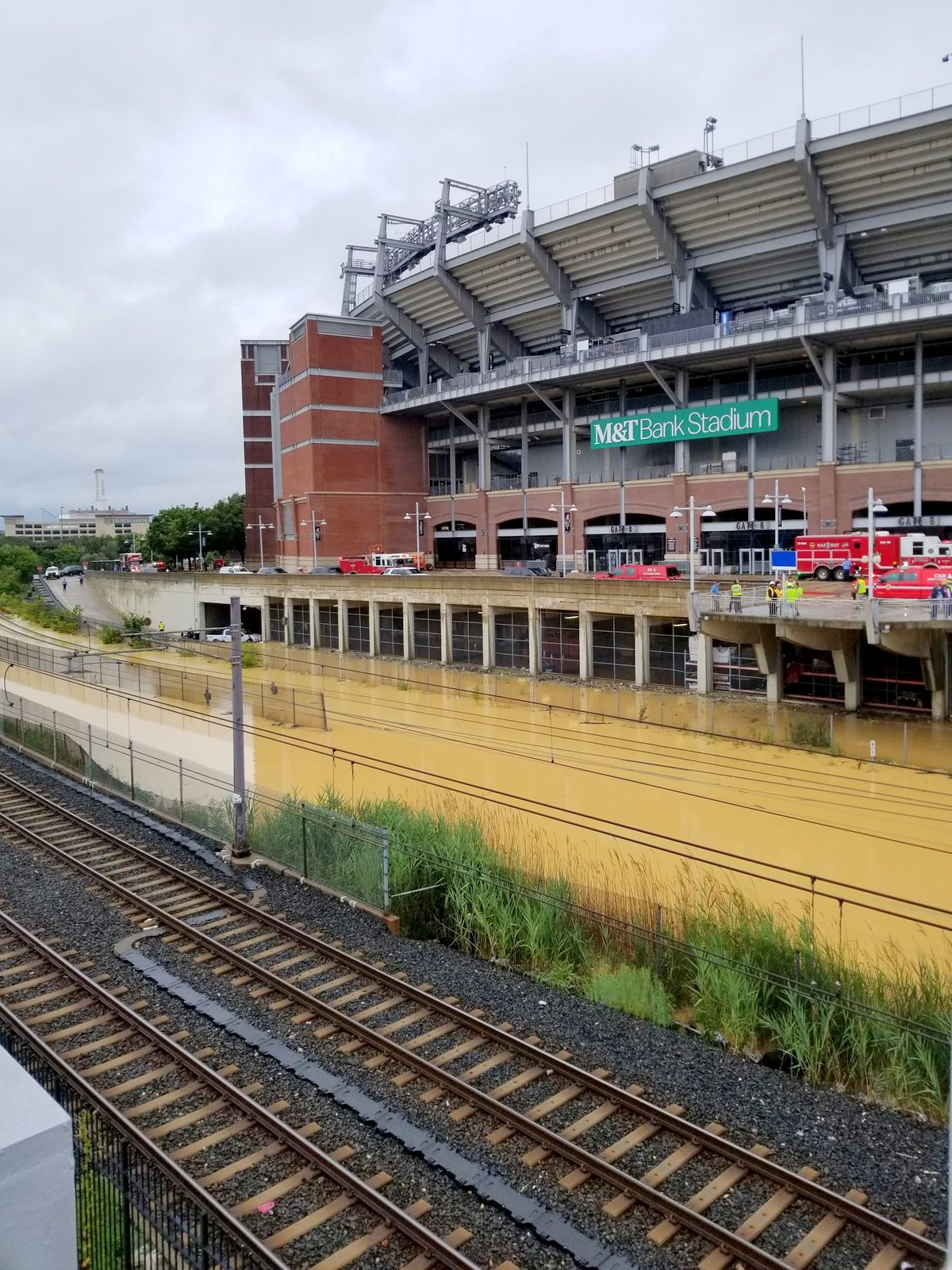 MARC train and CSX tracks were shut down Monday after a water main break caused flooding on the tracks near M&T Bank Stadium. (@Baltimore DPW)