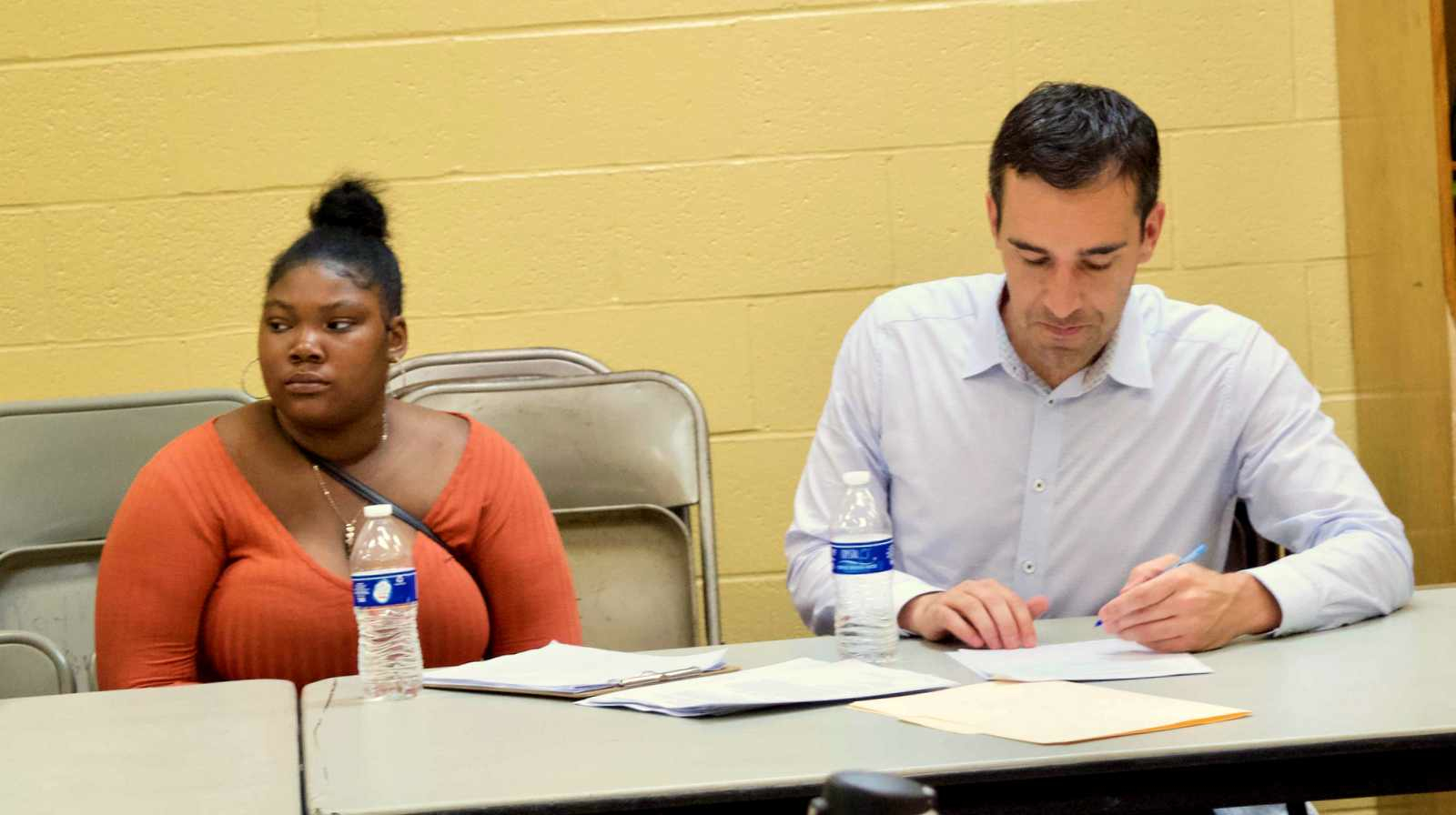Byronna Harris says the counseling done after last February's shooting at Frederick Douglass High School was of minimal value. Sitting to her left is Councilman Zeke Cohen. (Lizzie Kane)