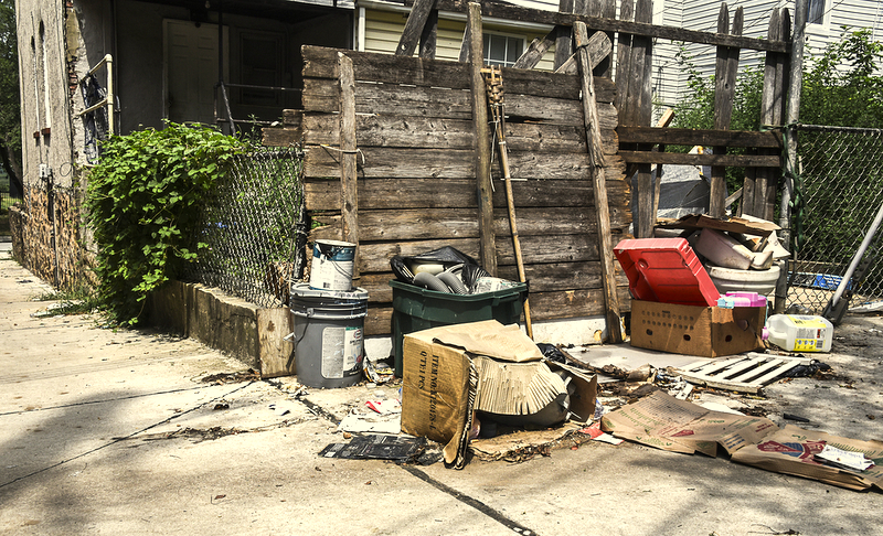 Paint and other household junk is scattered in an alley off Patapsco Avenue. (J.M. Giordano)