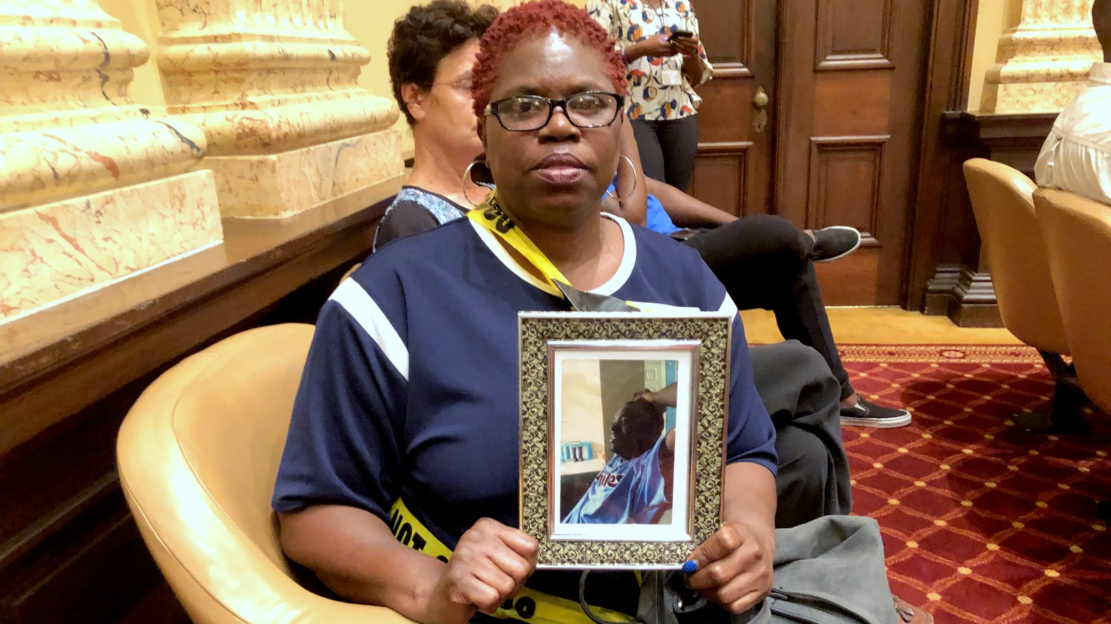 Marcella Holloman Hill, with a photo of her son who was shot and killed in 2012. (Fern Shen)
