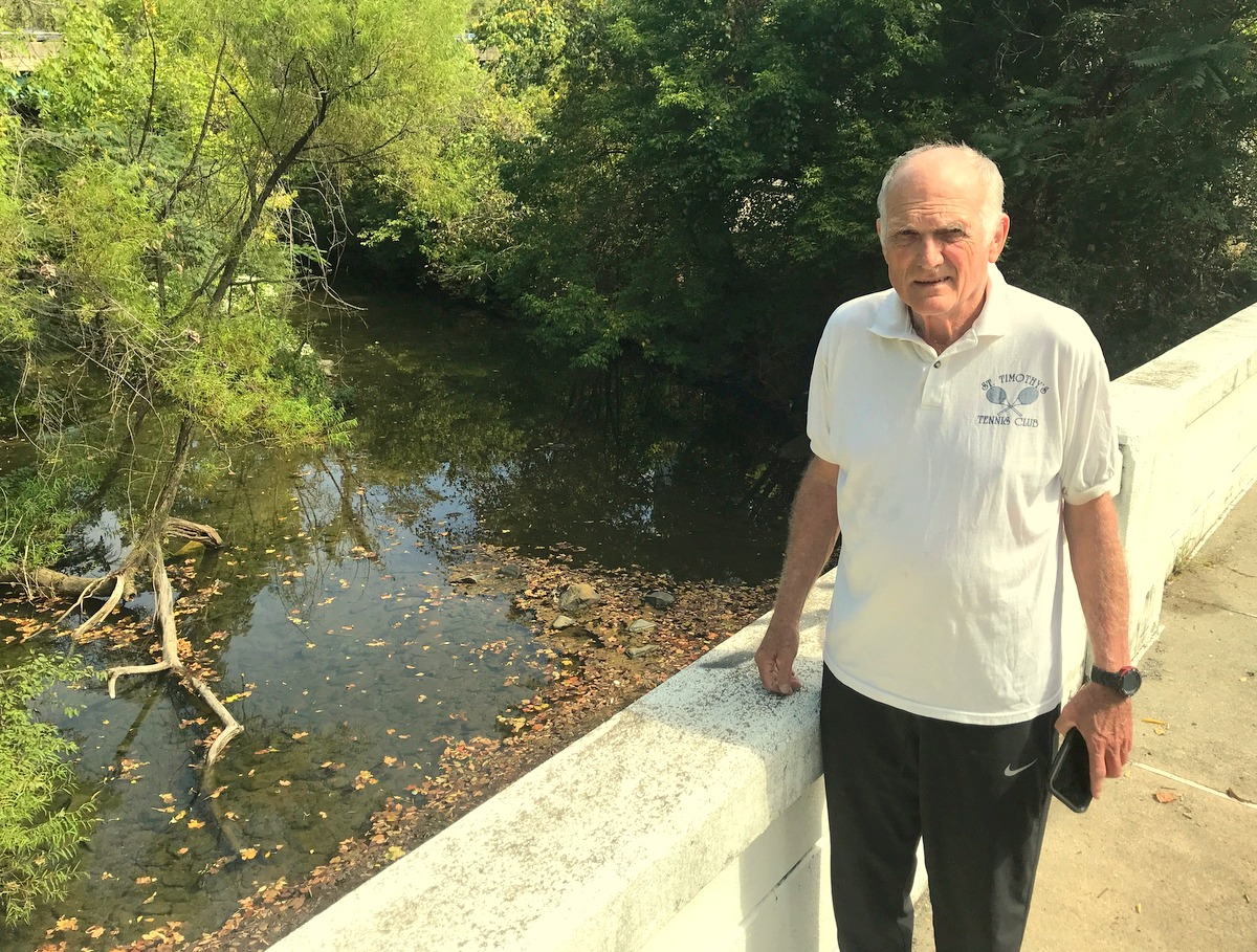 George Farrant at the Ingelside Avenue bridge where a broke water main sent tens of thousands of gallons of chlorinated water into Dead Creek pictured below. (Mark Reutter)
