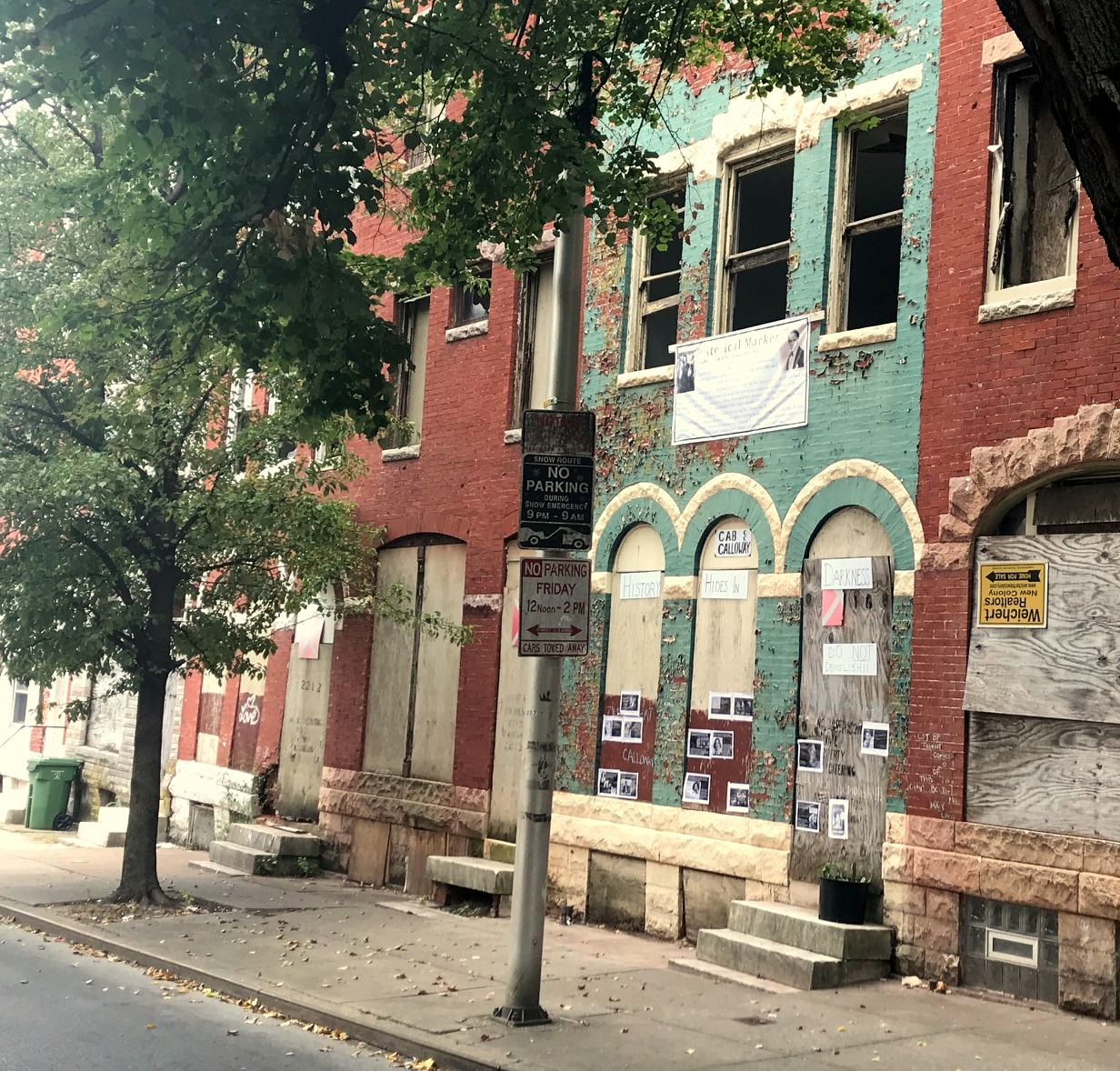 The Cab Calloway house, festooned with signs calling on it to preserved, is among a row of city-owned vacants that HCD today confirmed will soon be torn down. (Mark Reutter)