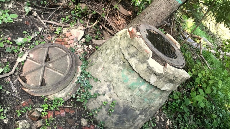 Damaged manhole stack following the sewer overflow from the lake Roland interceptor pipe in August. (Mark Reutter)