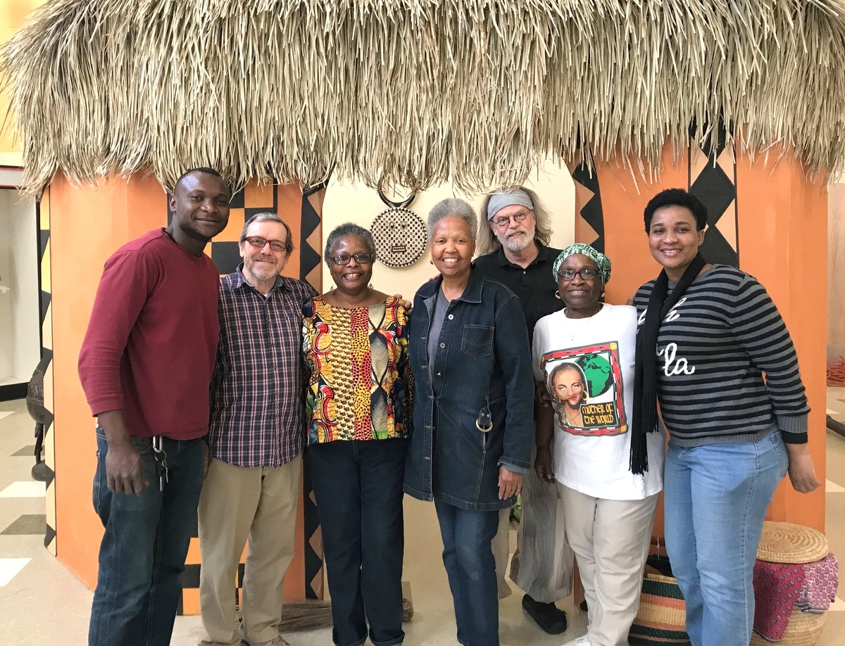 GETTING READY FOR THE OPEN HOUSE: Djouma Sidibe, Jim Clemmer, Esther Armstrong, Deborah Mason (museum director), John Viles (exhibit designer), Zattura Sims-El and Madeline Mendy. (Mark Reutter)