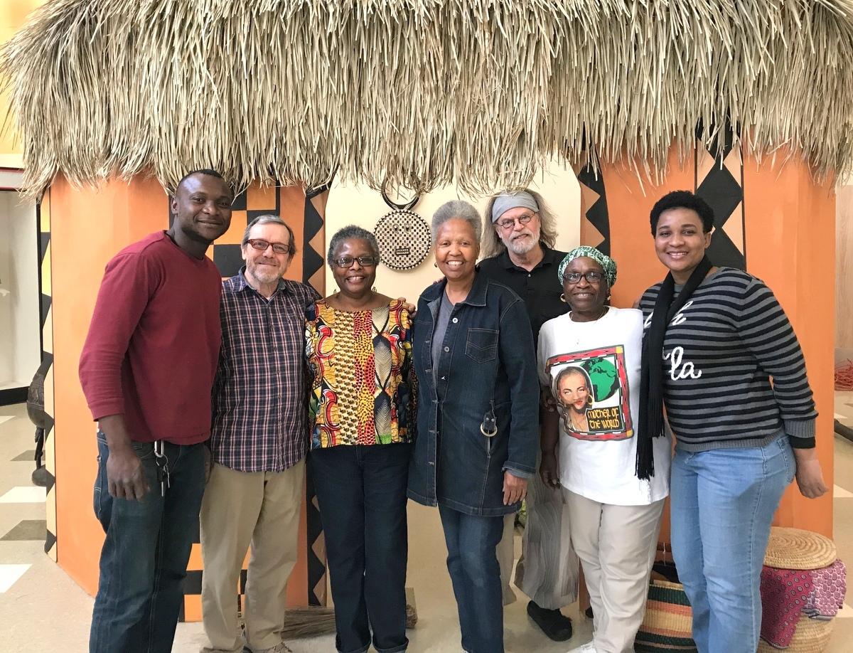 GETTING READY FOR THE OPEN HOUSE: Djouma Sidibe, Jim Clemmer, Esther Armstrong, Deborah Mason (museum director), John Viles (exhibit designer), Zattura Sims-El and Madeline Mendy. (Mark Reutter)