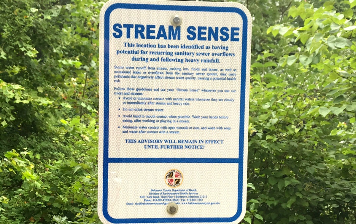 Warnings of contaminated water are posted around Lake Roland Park by the county health department, which consistently finds high bacteria counts in sampled water. (Mark Reutter)