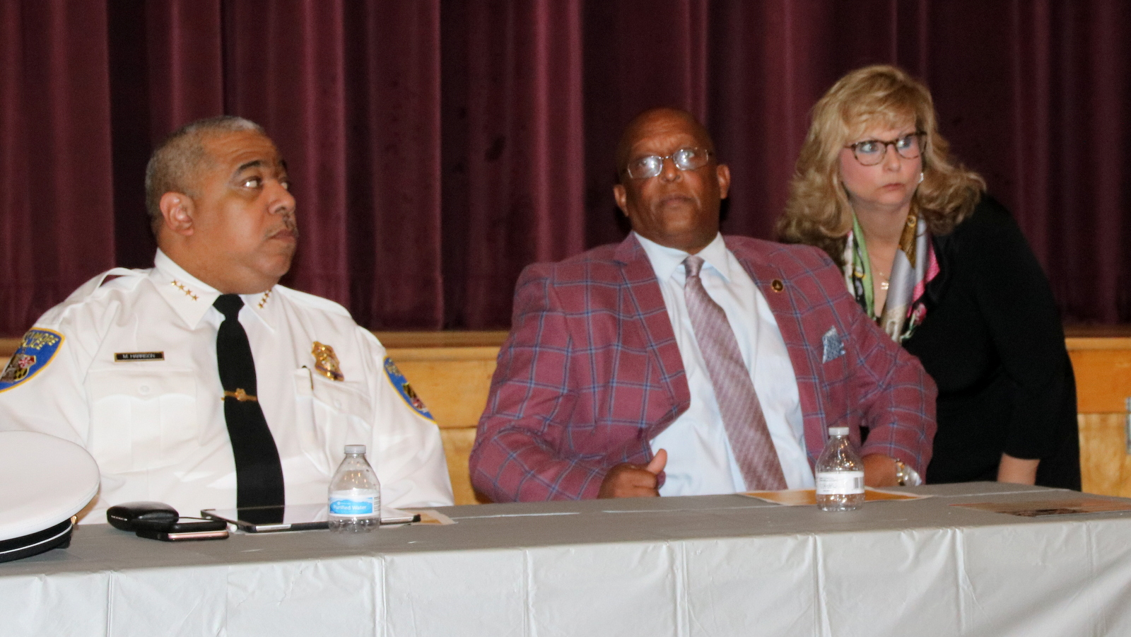Police Commissioner Michael Harrison and Mayor Jack Young at a recent meeting where residents voiced concern about the departure of the police training academy from a building in Northwest Baltimore. (Fern Shen)