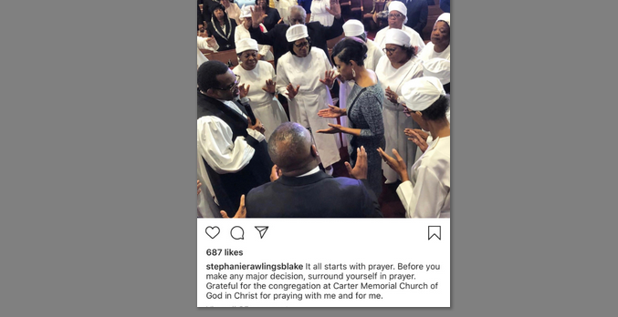 A picture of Stephanie Rawlings praying at Carter Memorial Church on November 3 was posted on her Instagram. (@stephanierawlingsblake)