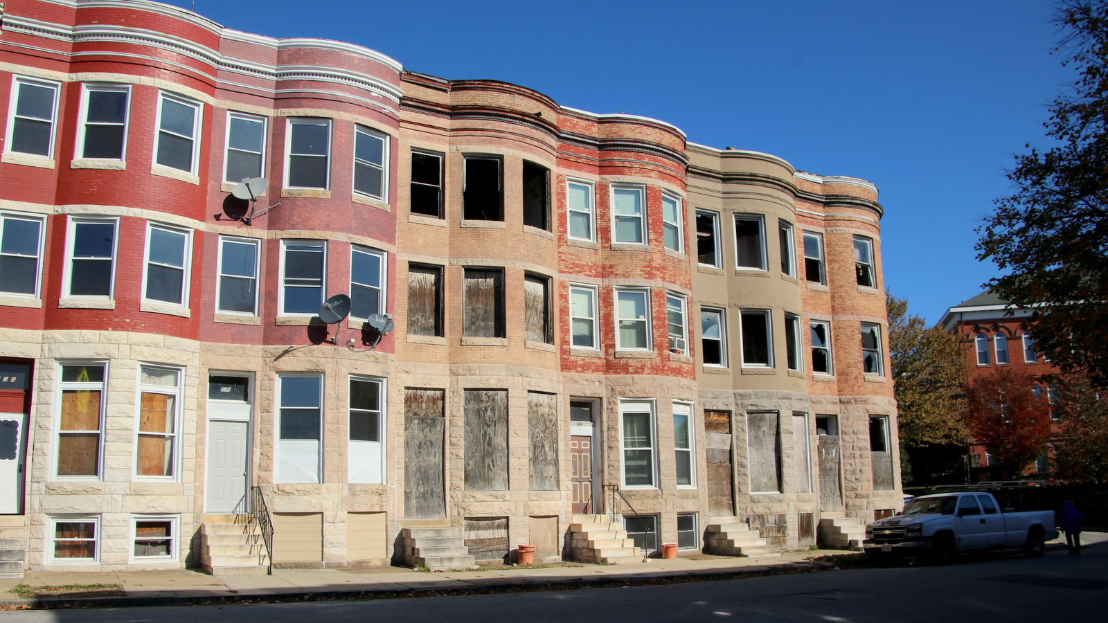 Like many places in Baltimore, abandoned rowhouses along East 22nd Street plague parts of the district. (Fern Shen)