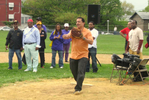 Grant throws the opening pitch for the James Mosher Baseball League. In addition to supporting youth programs, Grant has sat on the boards of the Baltimore Museum of Art and Red Cross and been active in the United Way. (Facebook)