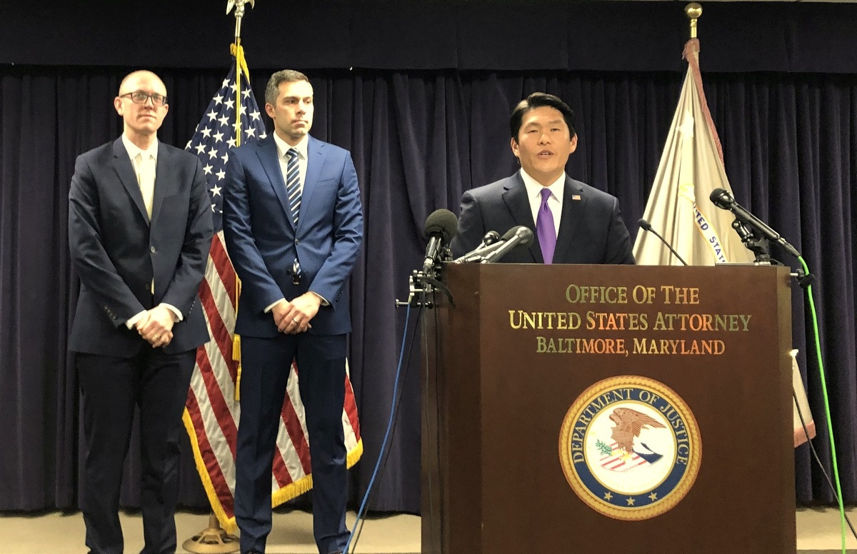 U.S. Attorney for Maryland Robert Hur announces today the charges against former Delegate Glenn. To his right are federal prosecutors Derek E. Hines and Leo J. Wise. (Fern Shen)