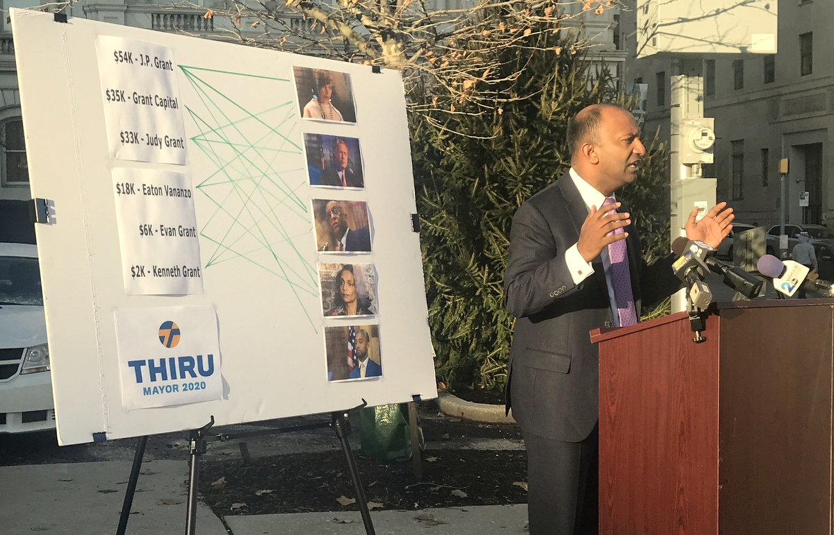 Thiru Vignarajah, a former deputy attorney general and federal prosecutor who is running for mayor, denounces the Grant contract in front of City Hall this morning. (Mark Reutter)