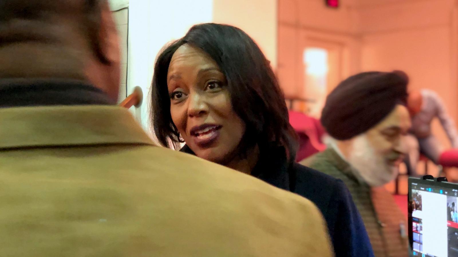 Maya Rockeymoore Cummings speaks with an audience member after the debate. (Ian Round)