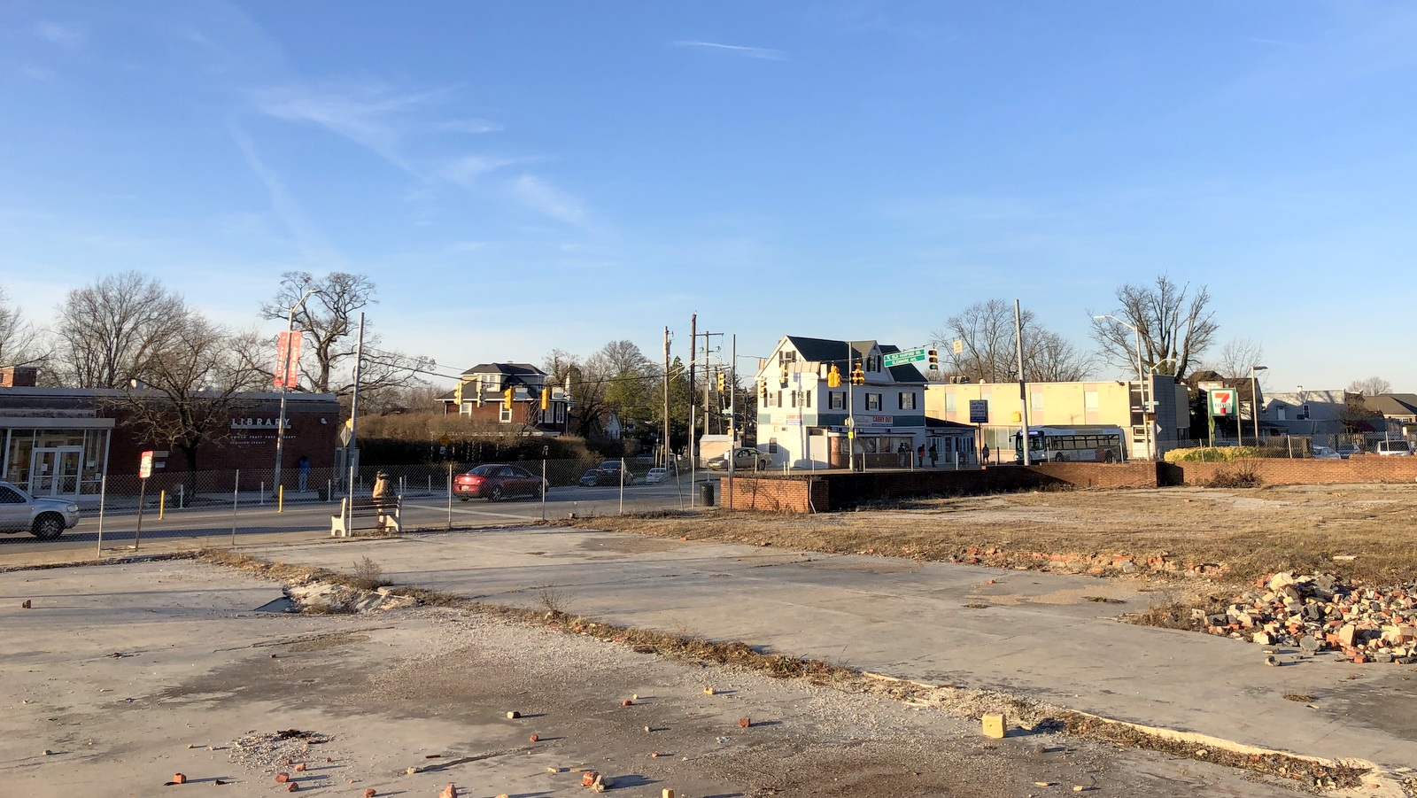 Site of the proposed Royal Farms store at the Glenmore Avenue, Harford Road intersection. Beyond the lot at left, a Pratt Library branch. (Ian Round)