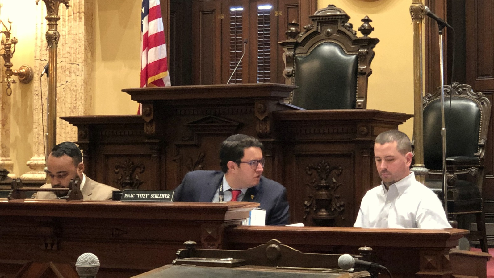 Councilmen Kris Burnett, Yitzy Schleifer and Eric Costello at yesterday's hearing on offering rebates to Baltimore residents installing home security cameras. (Ian Pound)