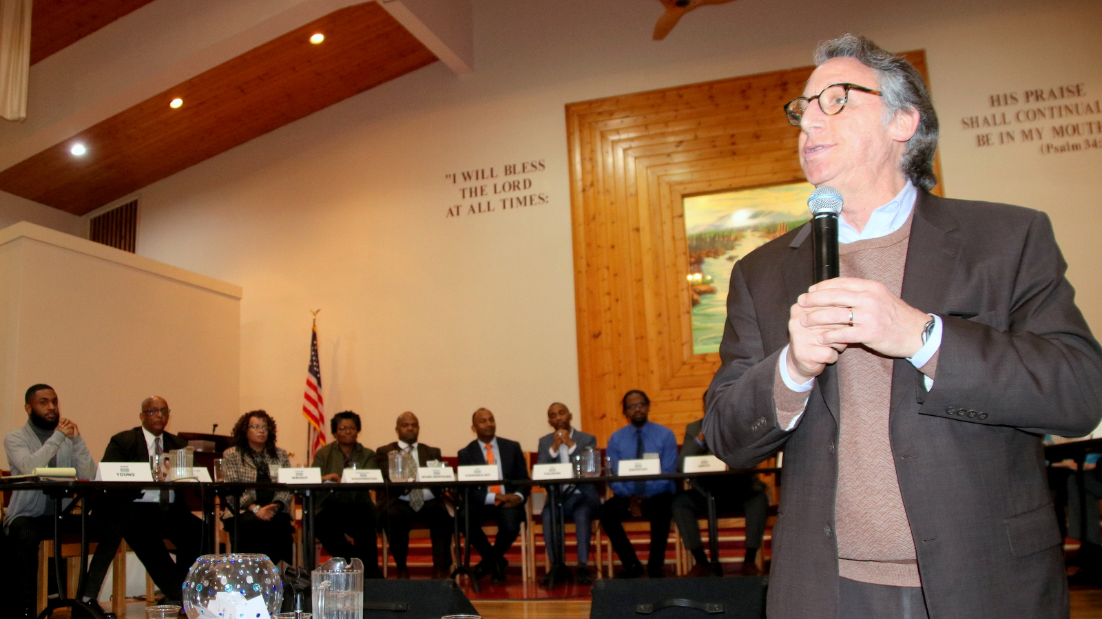 WYPR's Tom Hall, along with Dr. Sherri Parks, read questions to mayoral candidates. (Fern Shen)