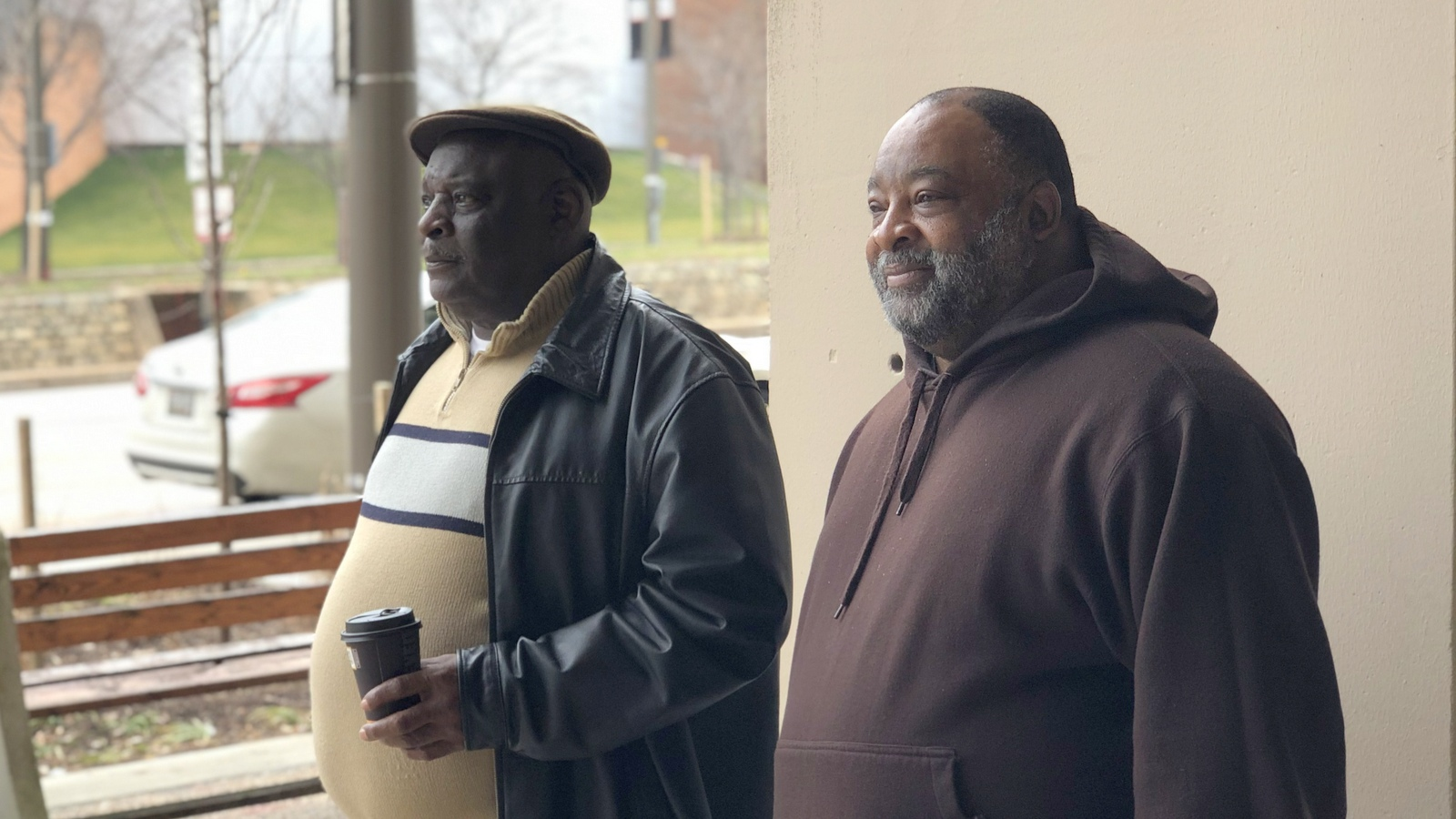 At a downtown Baltimore polling place, Alvin Jones and Donald Sketers offer bleak observations on the city. (Ian Round)