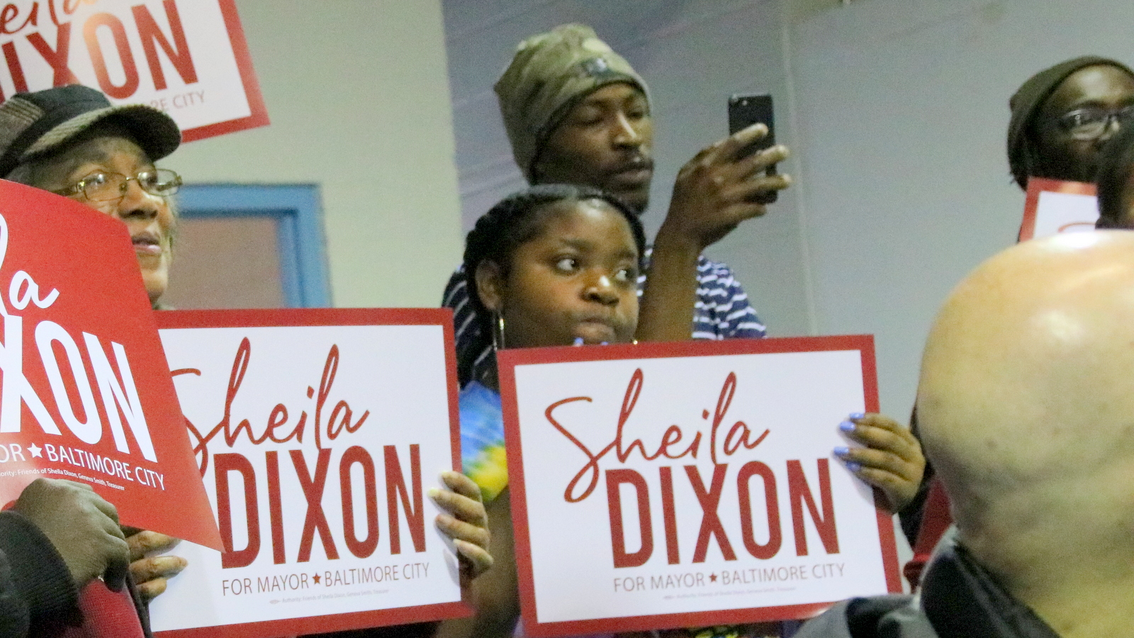 Dixon volunteer Michael Moore (holding phone) at her December 14, 2019 campaign kick-off. (Fern Shen)