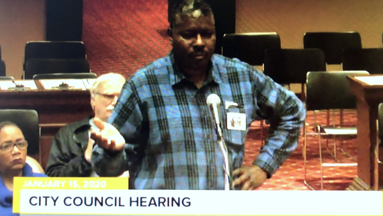 William Washington, a resident of the East Arlington neighborhood, speaks against the parking lot plan. (CharmTV)