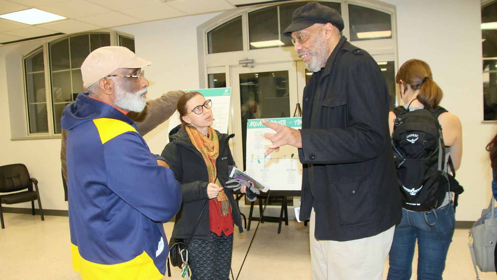 Ken Morgan (right) with fellow Druid Park Pool users discusses the city's planned renovations there. (Fern Shen)