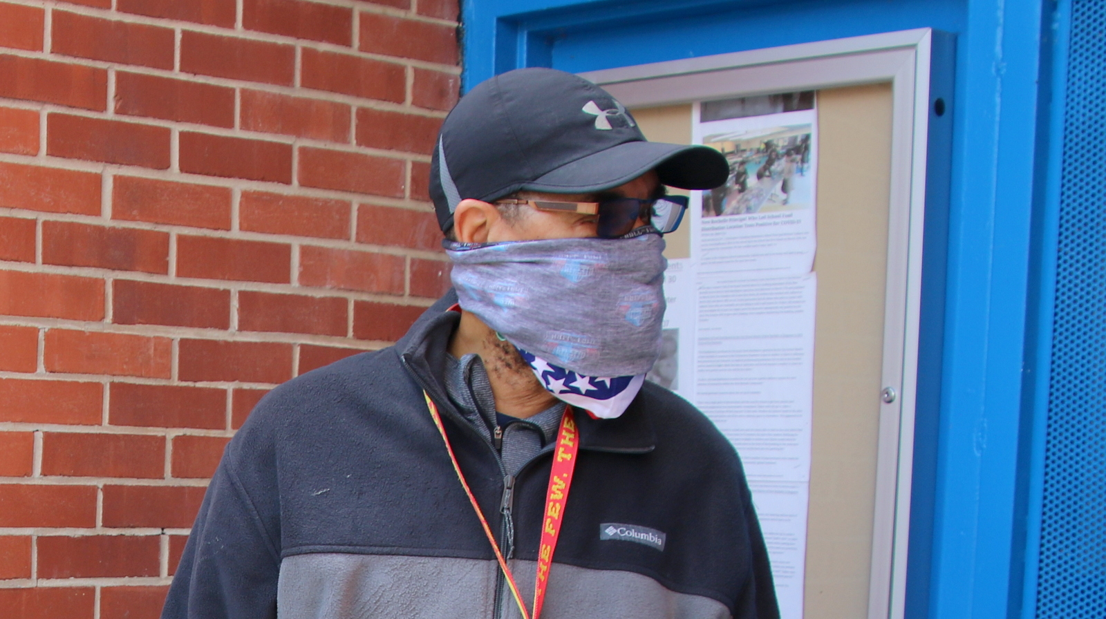 In Northwest Baltimore, a man covers his face with cloth bandanas. (Louis Krauss)