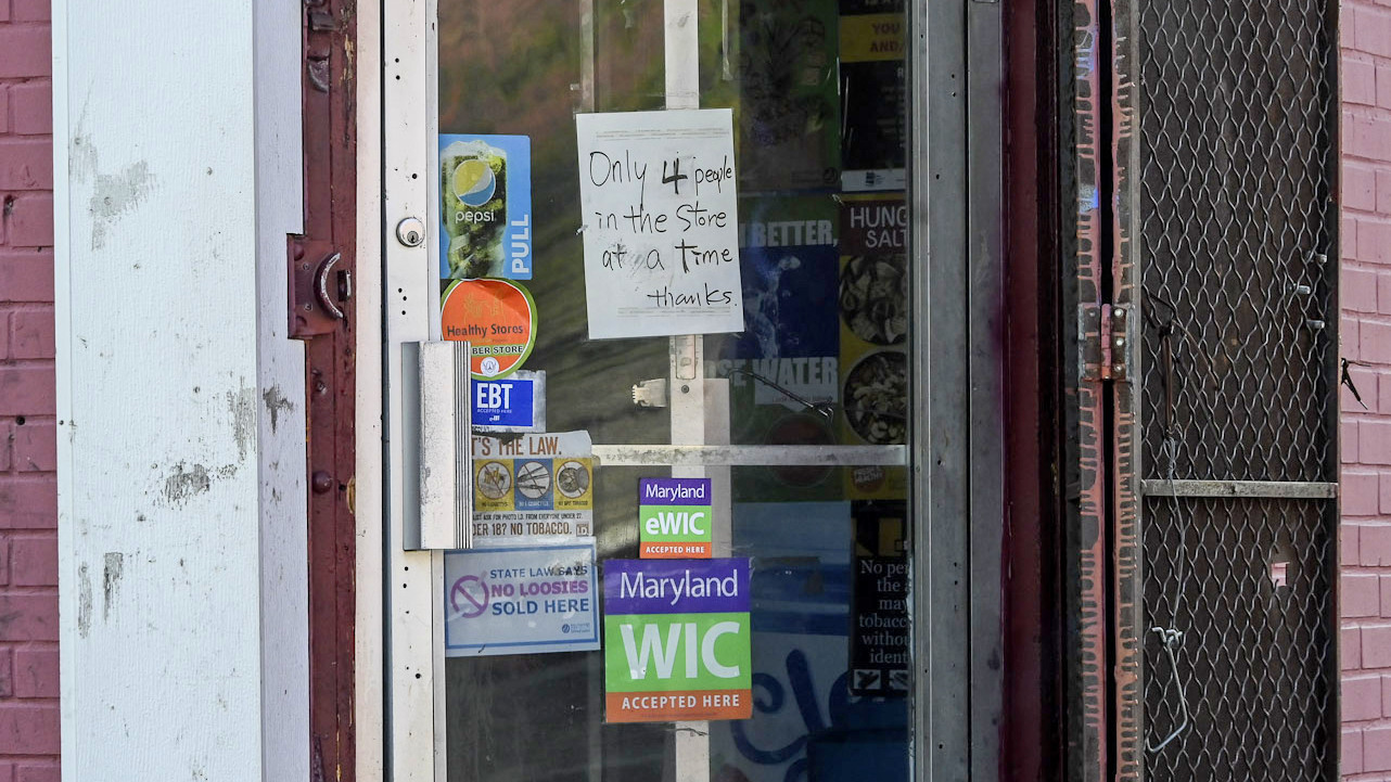 Some west Baltimore carryouts are encouraging social distancing. (J.M. Giordano)