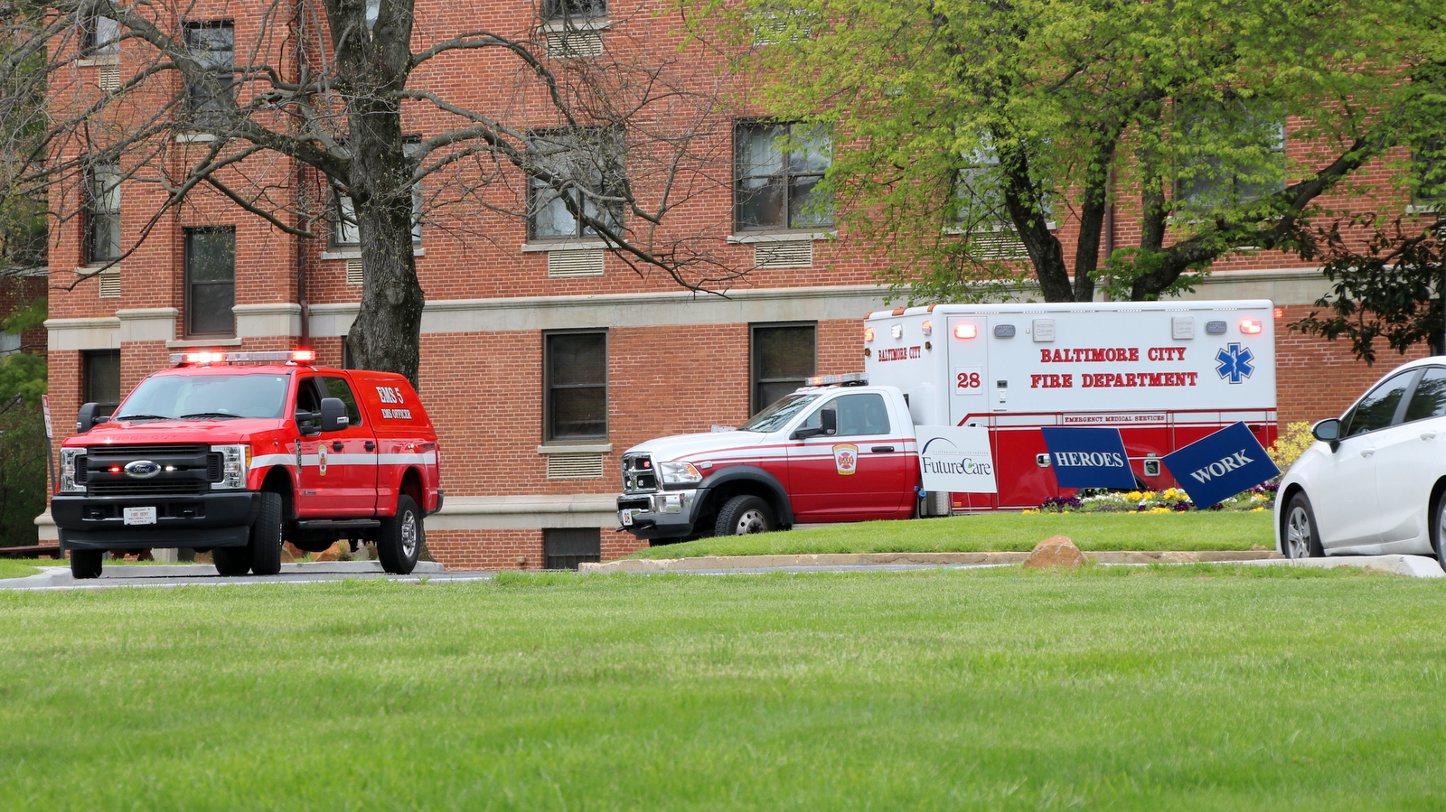 EMS vehicle and ambulance outside FutureCare Lochearn, a Baltimore nursing home with where 170 residents and staff were found Covid-positive. (Louis Krauss)
