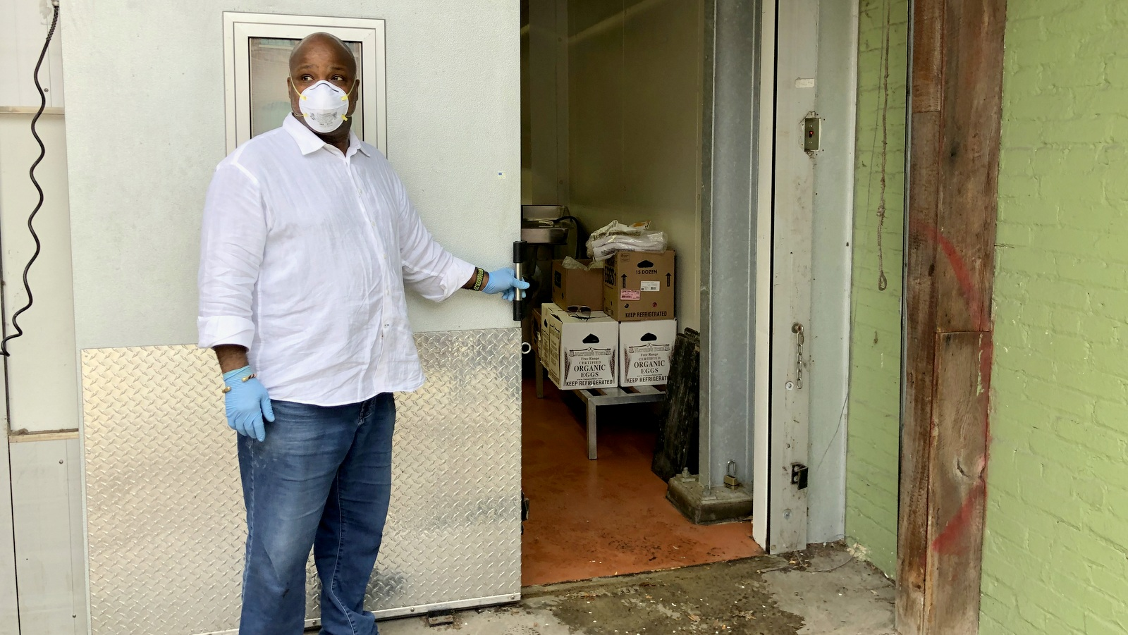 J.C. Faulk shows some of the donated food being stored at the former Parts & Labor restaurant. (Ian Round)