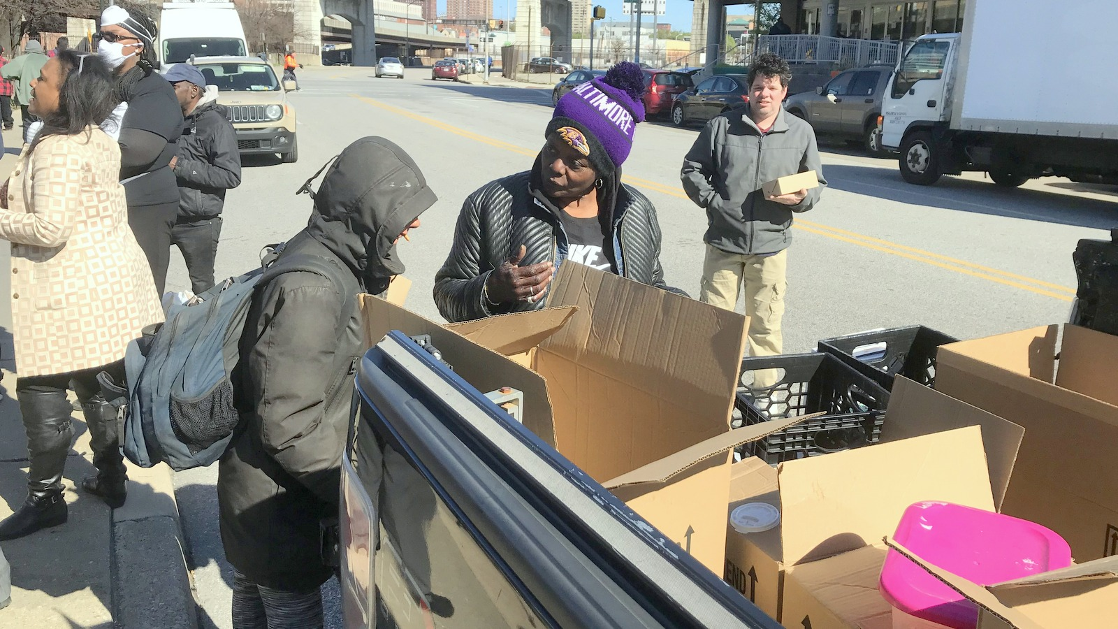 Ralanda Allah and others at a food giveaway outside Health Care for the Homeless. (Louis Krauss)