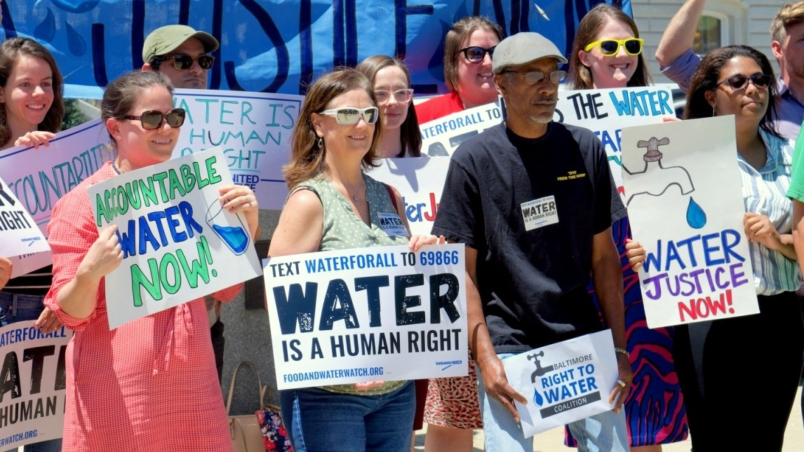 Activists rally last July in front of City Hall for a water affordability bill. (Lizzie Kane)
