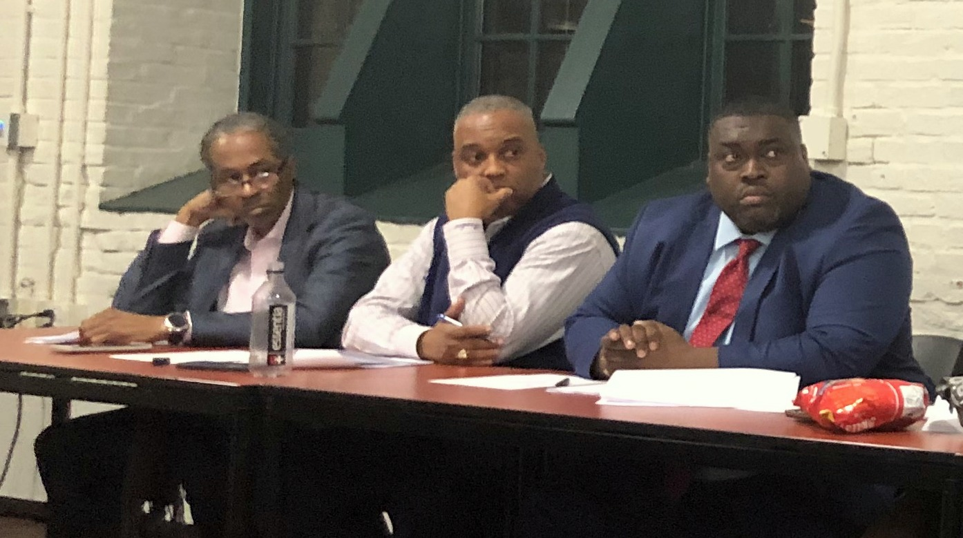 Antonio Glover (center) at the 45th District Central Committee meeting last January to fill the vacancy created by the resignation of indicted delegate Cheryl Glenn. (Fern Shen)