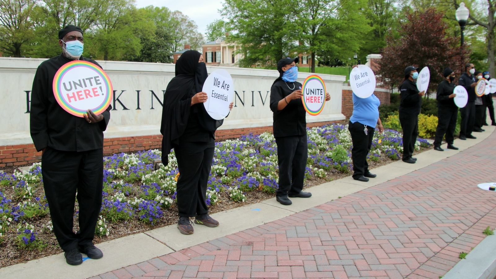 Organized by UNITE HERE Local 7, food service workers protest outside Johns Hopkins Homewood campus. (Fern Shen)