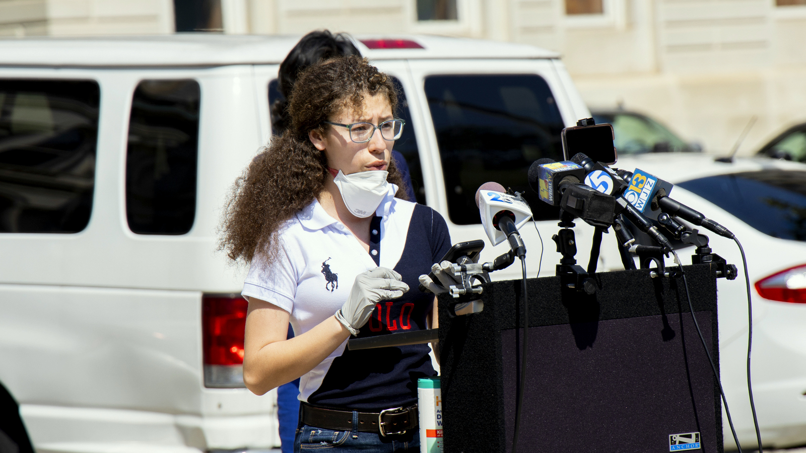 Franca Muller Paz speaks at the rally in front of City Hall today. (Nicholas Mackall)