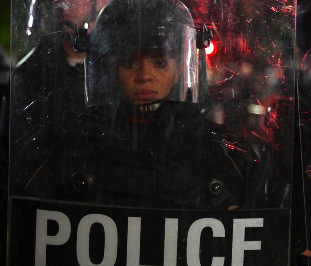 policewoman in riot gear