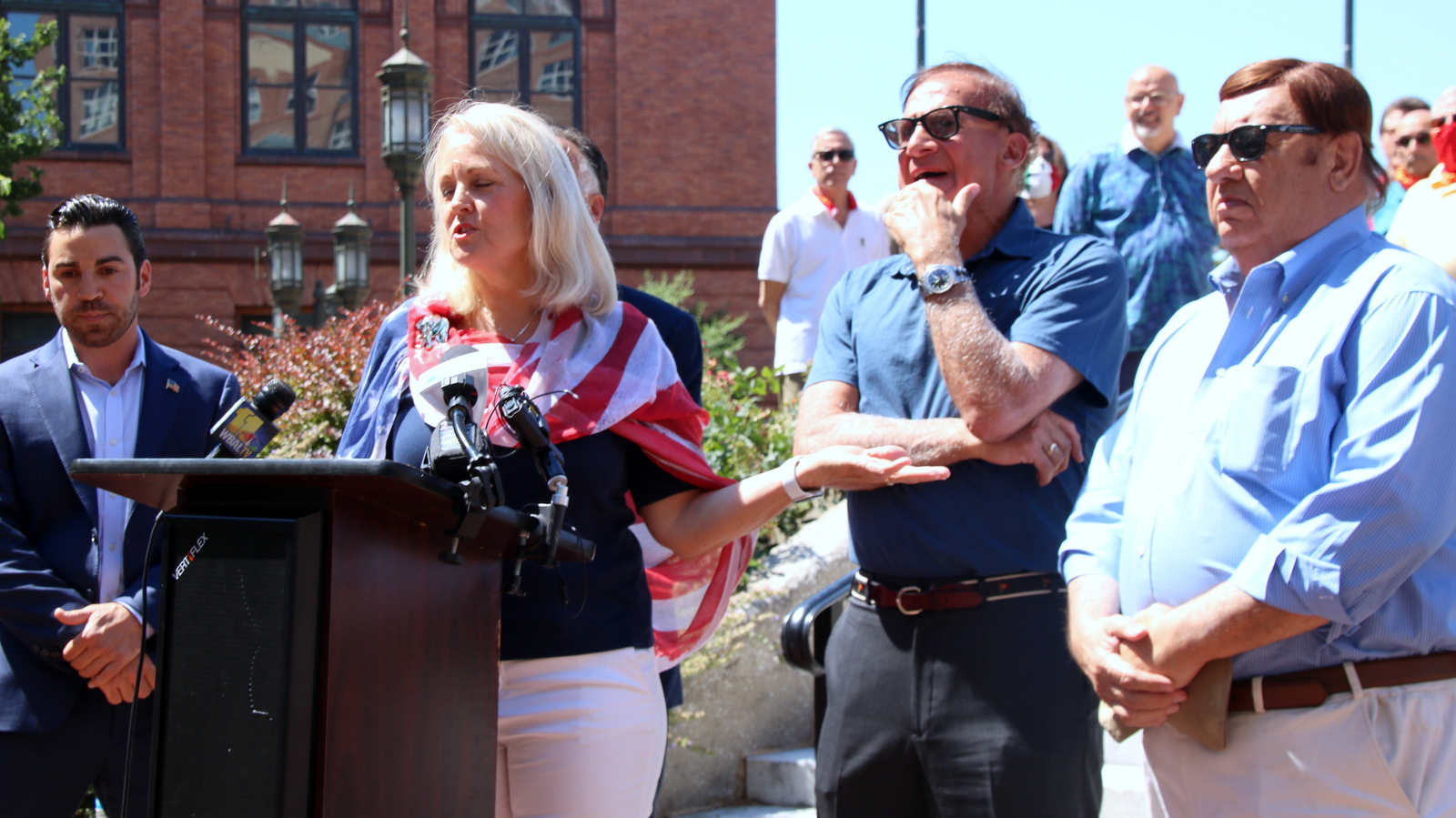 Nino Mangione, Kathy Szeliga, John Pica and Pat McDonough at the Columbus statue in Baltimore. (Louis Krauss)