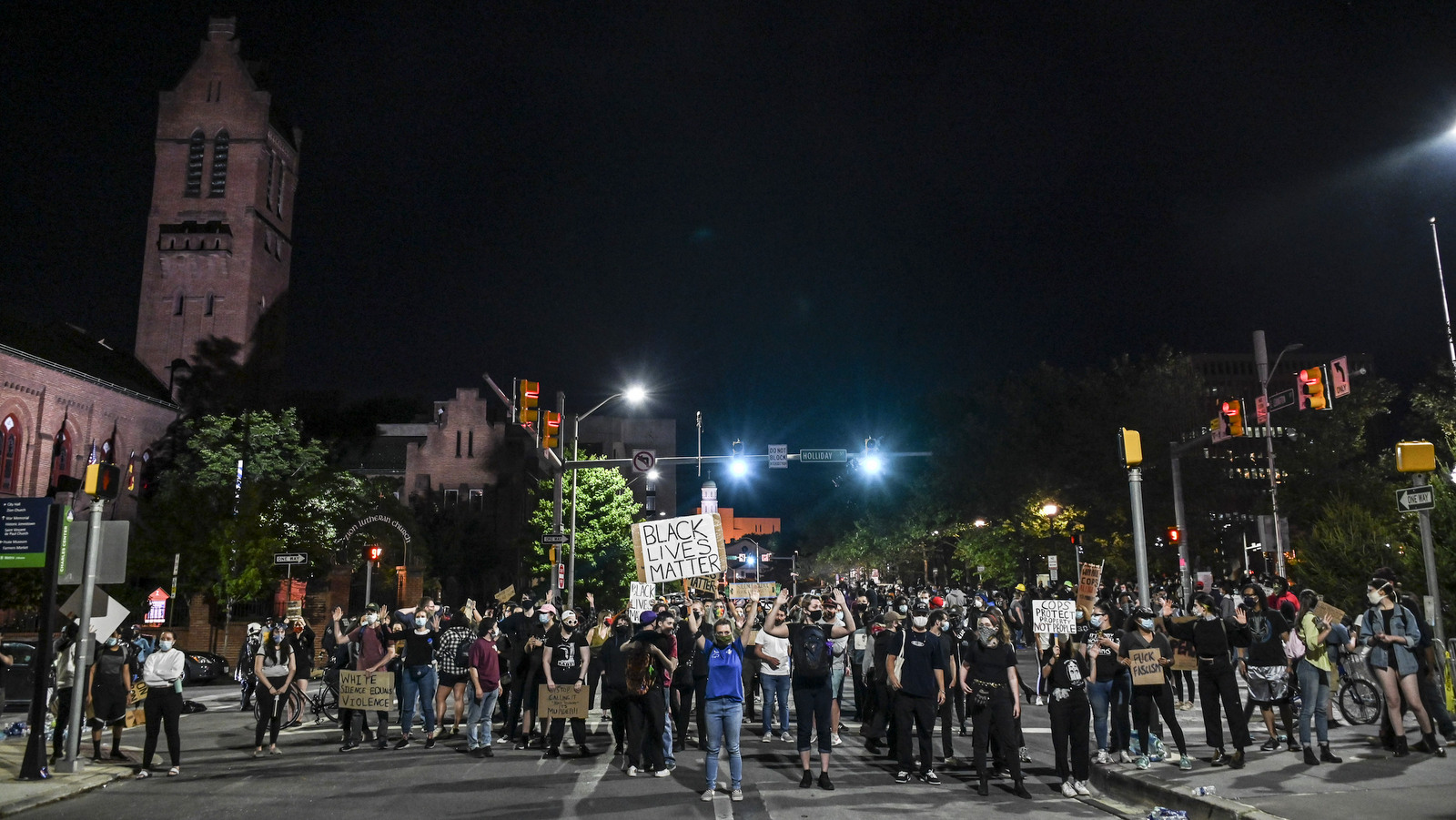 Protesters at the corner of South and East Baltimore streets. (J.M. Giordano)