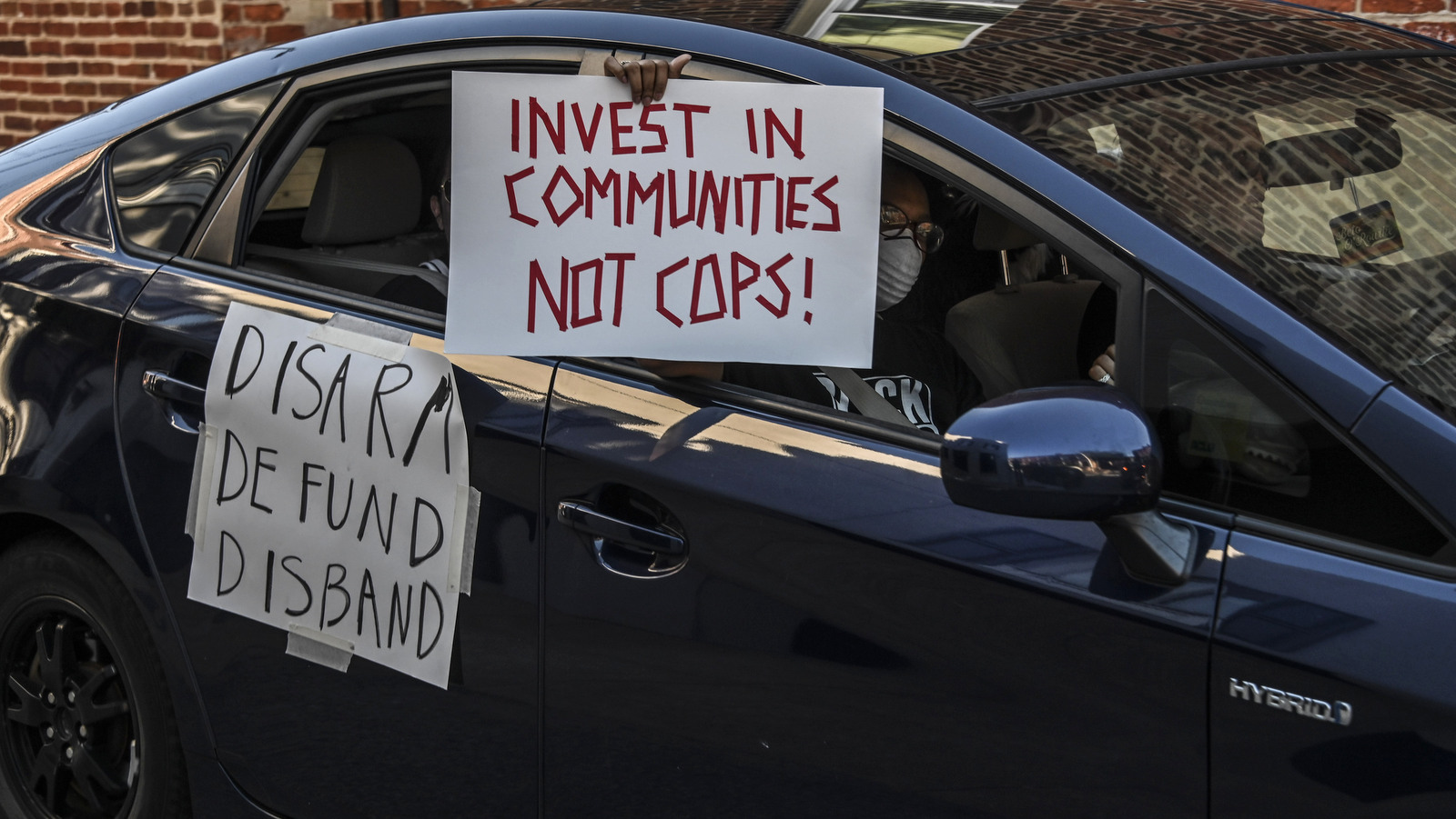 Part of an hourlong protest caravan outside the home of City Councilman Eric Costello. (J.M. Giordano)